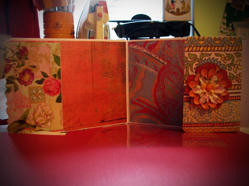 Envelope book swap. Front and 1 spread. This uses business size envelopes and scrapbook paper. Tutorial here.