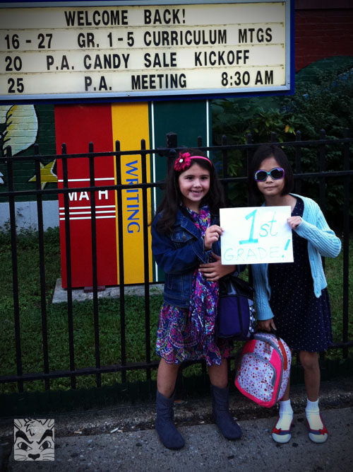Posing in front of school with her best bud.