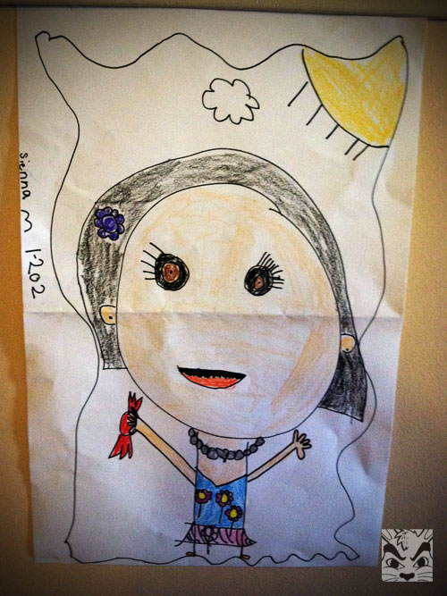 She drew this portrait of herself. I love it! Of course she is holding a piece of candy. LOL. I don't know what happened to her nose, tho!
