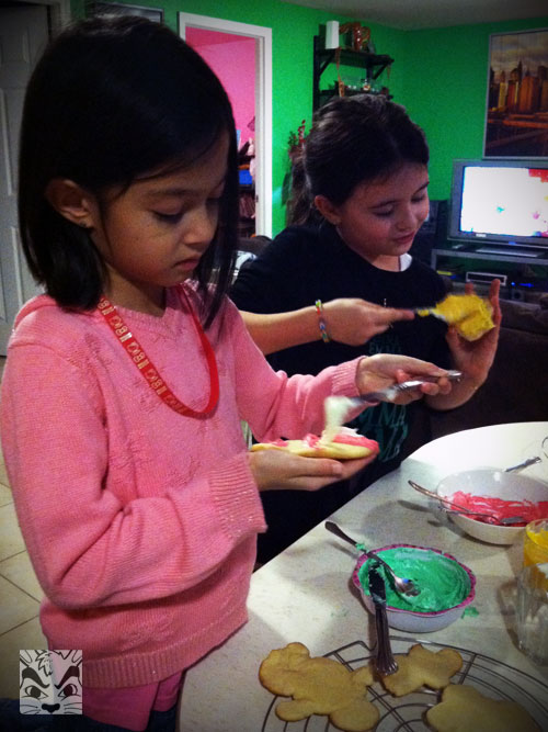 Decorating cookies with her BFF Emma