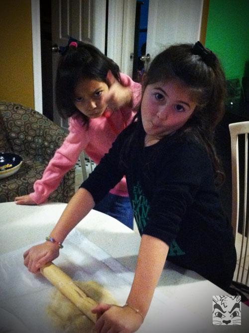 Being silly while rolling cookies!