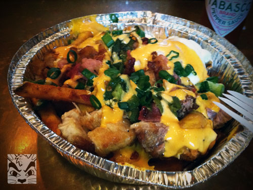 We shared an order of their special fries! Stick fries, tator tots, cheese, bacon, jalapeno and runny egg. MMMM! So getting this again!