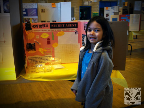 Posing at the fair with her project.