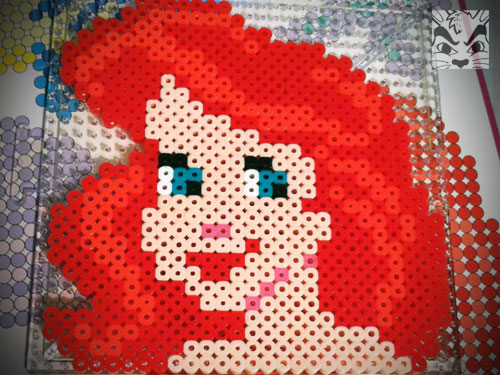 Sienna helped me with this perler Ariel. We did a few other perler projects and this one was the biggest. It took quite a few days to finish.