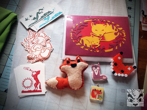 Also for a swap, a fox swap, I made these fox related items. I did a variety of things. Cards with the Silhouette, a perler bead fox, a carved rubber stamp, a pendant, a felt stuffie and some stamped stickers. I love being able to make everything!
