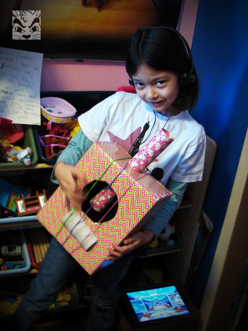 Back in January, Sienna requested a guitar. Coming right after Christmas, I thought she was crazy to ask for something else! I made her one instead, which she uses often! I have since decorated that last cardboard piece under the rubber bands. (I found this tutorial online!)