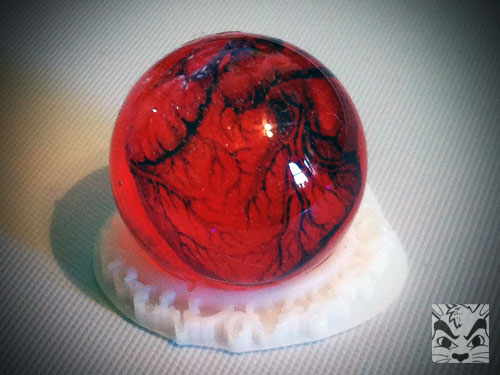 An experiment with a sphere mold. Inside is an image of a anatomical correct heart. Next time I need to make the image smaller as the resin magnifies it.