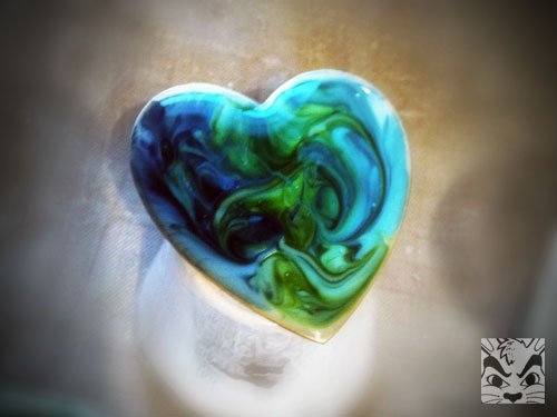Playing with resin and alcohol ink. I love how the colors swirled around.